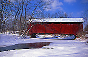 PA red covered bridge in snow