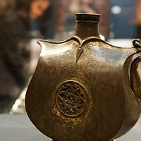 London October 2nd  Art of the Islamic World  photocall at Sotheby for the auction  on 7th |October 2009 .  A  gilt metal (tombak)  water flask  from the 16th Century  This flask is one of only 3 published and the other two being at the British Museum and The Metropolitan Museum of Art ...***Standard Licence  Fee's Apply To All Image Use***.Marco Secchi /Xianpix. tel +44 (0) 845 050 6211. e-mail ms@msecchi.com or sales@xianpix.com.www.marcosecchi.com