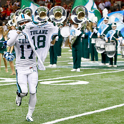 September 22, 2012; New Orleans, LA, USA; Tulane Green Wave cornerback Alex Lauricella (17) holds up the jersey of safety Devon Walker (18) as the team runs on the field before a game against the Ole Miss Rebels at the Mercedes-Benz Superdome. Walker suffered a fractured spine in the collision with a teammate during the first week of the season. Mandatory Credit: Derick E. Hingle-USA TODAY SPORTS