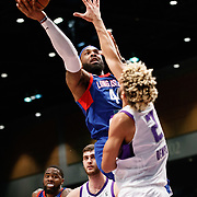 Long Island Nets Forward JJ MOORE (44) shoots over Reno Bighorns Guard CODY DEMPS (2) during the NBA G-League Basketball game between the Reno Bighorns and the Long Island Nets at the Reno Events Center in Reno, Nevada.