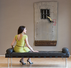 Bonhams, London, March 6th 2017. Fine art auctioneers Bonhams hold a preview in London  for their upcoming Post-War and Contemporary Art Sale which takes place on March 8th 2017. PICTURED: A woman sits in front of  Banksy's 'Jailbreak' valued at £100,000 - £150,000.