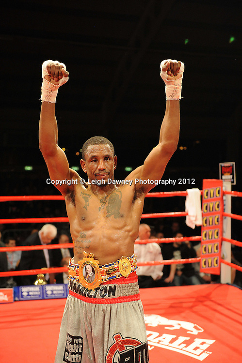 Darren Hamilton (silver shorts) defeats Ashely Theophane in a 12x3 contest to claim the British Light Welterweight Title at the Aintree Equestrian Centre, Liverpool on the 19th May 2012. Frank Maloney Promotions © Leigh Dawney Photography 2012.