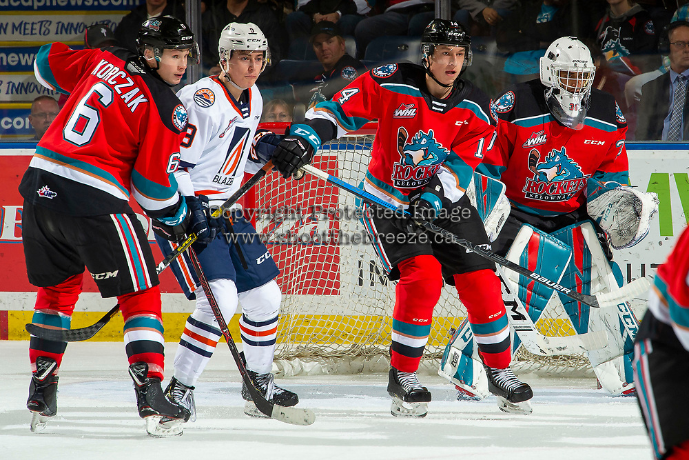 KELOWNA, BC - OCTOBER 12: Kaedan Korczak #6 and Elias Carmichael #14 of the Kelowna Rockets defend the zone as Josh Pillar #9 of the Kamloops Blazers looks for the pass in front of the net of Roman Basran #30 of the Kelowna Rockets at Prospera Place on October 12, 2019 in Kelowna, Canada. (Photo by Marissa Baecker/Shoot the Breeze)