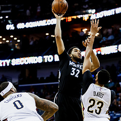 Mar 19, 2017; New Orleans, LA, USA; Minnesota Timberwolves center Karl-Anthony Towns (32) shoots over New Orleans Pelicans forward Anthony Davis (23) during the first quarter of a game at the Smoothie King Center. Mandatory Credit: Derick E. Hingle-USA TODAY Sports