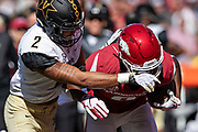 FAYETTEVILLE, AR - OCTOBER 27:  Michael Woods #8 of the Arkansas Razorbacks is hit and pushed out of bounds by Frank Coppet #2 of the Vanderbilt Commodores at Razorback Stadium on October 27, 2018 in Fayetteville, Arkansas.  The Commodores defeated the Razorbacks 45-31.  (Photo by Wesley Hitt/Getty Images) *** Local Caption *** Michael Woods; Frank Coppet
