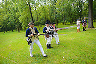 8/18/12 11:45:24 AM - Warwick, PA. -- John Godzieba of Langhorne, Pennsylvania demonstrates the use of a rifle during a revolutionary war reenactment at the Moland House August 18, 2012 in Warwick, Pennsylvania. -- (Photo by William Thomas Cain/Cain Images)