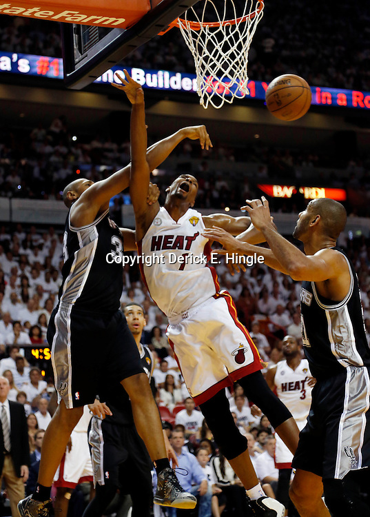 Jun 9, 2013; Miami, FL, USA;  Miami Heat center Chris Bosh (1) drives to the basket against San Antonio Spurs center Boris Diaw (33) and power forward Tim Duncan (right) during the first quarter of game two of the 2013 NBA Finals at the American Airlines Arena. Mandatory Credit: Derick E. Hingle-USA TODAY Sports