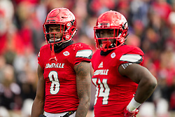 Louisville quarterback Lamar Jackson, left, and running back Brandon Radcliff. The University of Louisville hosted Kentucky, Saturday, Nov. 26, 2016 at Papa John's Cardinal Stadium in Louisville. Kentucky won the game 41-38.