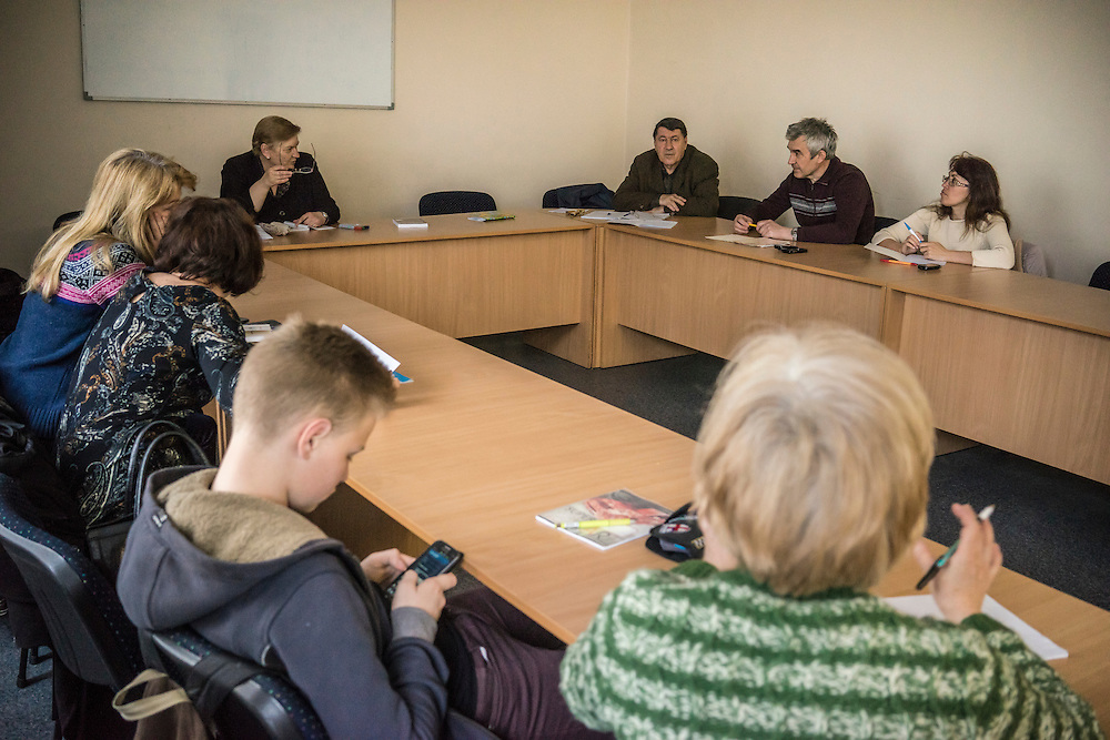 Ewa Holodkova, 67, upper left, from the town of Stakhanov in Lugansk oblast, teaches a Polish language class to students of whom many are IDPs from eastern Ukraine on Tuesday, April 28, 2015 in Lviv, Ukraine. Despite being a Polish citizen and she and her husband having the legal right to live in Poland, where they have a daughter, their Ukrainian pensions are too small to afford life in Poland. CREDIT: Brendan Hoffman/Prime for the Wall Street Journal UKRMIGRATION CREDIT: Brendan Hoffman/Prime for the Wall Street Journal UKRMIGRATION