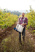 James Kohn of Wandering Aengus Cidery picks apples for making cider.
