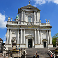Cathedral of St. Ursus and Basle Gate in Solothurn, Switzerland<br /> Up this staircase is the Cathedral of St. Urs and Viktor, a magnificent Roman Catholic church that was finished in 1773.  Its baroque and neo-classical style, with Corinthian columns and a copper dome above the bell tower, was built with white Jura limestone.  On the left is Basel Gate, which was built in the early 16th century as the eastern entrance to the fortified town.