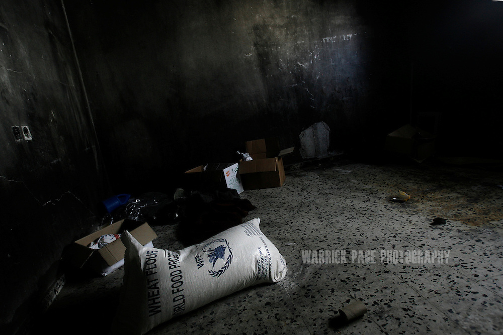 ATATRA, GAZA STRIP - JUNE 4: A bag of food aid lies on the floor of a burnt room in the Abu Halima home, June 4, 2009, in Atatra, Gaza Strip. The family has been unable to afford to repair the damaged to their home after a white phosphorus artillery strike burst through the ceiling, killing eight family members, while two others were shot dead while trying to evacuate the wounded during the recent war in Gaza. Not since Fallujah or Grozny has white phosphorus been used so extensively in a civilian area. Phosphorus shells are legal to use as a battlefield obscurant in unpopulated areas, but are banned from use under the UN's Convention on Conventional Weapons (CCW) where civilians may be harmed. (Photo by Warrick Page)