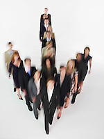 Group of Businesspeople in arrow formation blurred effect