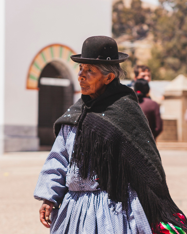 Ayamara style. This traditionally dressed (and of course bowler hatted) Ayamaran lady was in the town of Copacabana by Lake Titicaca 3,841 m (12,602 ft). The history of the bowler hat is mixed , but some say it was simply a shipment of hats or English workers that were too small, were given to the locals who adopted it as a part of traditional dress.