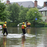 Heavy Rain in Perth causes flash flooding.....21.07.10<br /> Tayside Firefighters wade across Fairfield Avenue in Perth after heavy rain caused flash flooding<br /> Picture by Graeme Hart.<br /> Copyright Perthshire Picture Agency<br /> Tel: 01738 623350  Mobile: 07990 594431