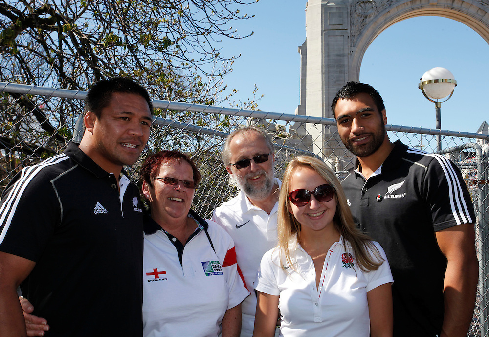 English tourists having their photo's taken with All Black Keven Mealanu, left and Victor Vito, right, during the All Blacks visit to Christchurch, New Zealand, Sunday, September 18, 2011.  Credit:SNPA / Pam Johnson