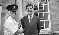 The New York Rose, Kelly Moran a member of the New York Police Departmant(NYPD) tries on a Garda Cap when the Roses visited Leinster House also in the picture is Minister for Labour Mr Dick Spring, 21/08/1986 (Part of the Independent Newspapers Ireland/NLI Collection).
