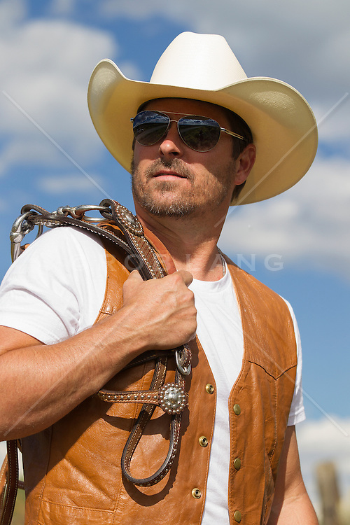 good looking forty something year old cowboy outdoors