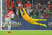 Flamengo goalkeeper Diego Alves (1) attempts to block a penalty kick by Ajax midfielder Bertrand Traore (23) during a Florida Cup match at Orlando City Stadium on Jan. 10, 2019 in Orlando, Florida. <br /> Flamengo won in penalties 4-3.<br /> <br /> ©2019 Scott A. Miller