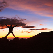 Gavriel Jecan strikes a pose at sunset on top of the Mauna Kea Volcano in Hawaii.
