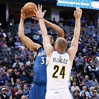 15 February 2017: Minnesota Timberwolves center Karl-Anthony Towns (32) goes for the baby hook over Denver Nuggets center Mason Plumlee (24) during the Minnesota Timberwolves 112-99 victory over the Denver Nuggets, at the Pepsi Center, Denver, Colorado, USA.