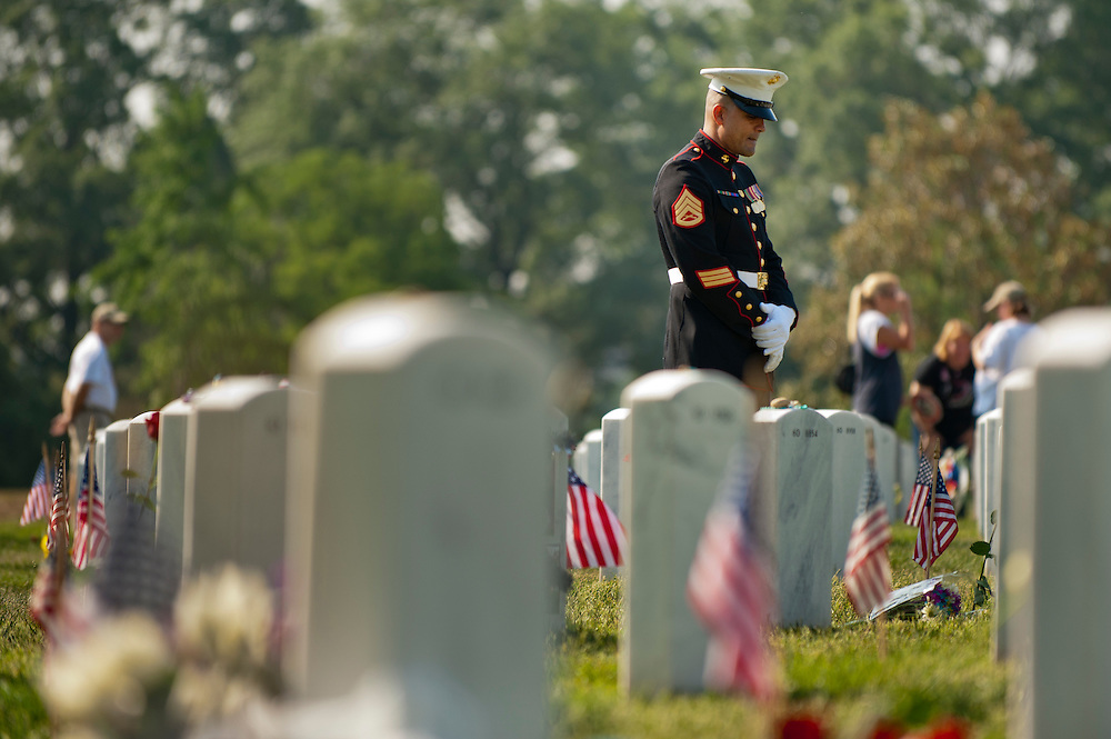 Marine SSgt. KERRY LALCHAN prays over the grave of his friend Marine Lance Cpl. Dennis James Burrow on Memorial Day in Section 60 of Arlington National Cemetery.