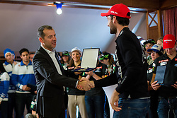 Enzo Smrekar gives award to Jakov Fak during Media day of Ski Association of Slovenia before new winter season 2014/15 on October 20, 2014 in Hisa Kulinarike Jezersek, Sora, Slovenia. (Photo by Matic Klansek Velej / Sportida)