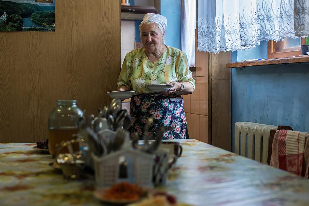 Valentina Semenivna serves food in the basement of Saint Pokrovsky Church on Thursday, October 16, 2014 in Donetsk, Ukraine. Photo by Brendan Hoffman, Freelance