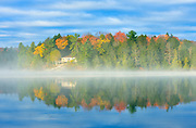 Cottage in morning fog on Horseshoe Lake<br /> Horseshoe Lake<br /> Ontario<br /> Canada