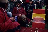 Mongolia. Chagai, Knuclebones games during a small naadam  in  Ik Uul Sum  Mongolia    /  - Chagai -  jeu d'osselets (durant un Naadam à Ih Uul Sum  Mongolie):   Ik Uul Sum  Mongolie Joueurs d'osselets lancés (shagay qarvaqtsh). A l'aide d'une petite rampe de lancement, les joueurs propulsent par une chiquenaude du majeur une pièce d'os biseautée carréiforme vers un chamboule-tout miniature constitué d'osselets. Ce jeu, réservé aux hommes de tous âges, se pratique surtout aux belles saisons de l'été et de l'automne. (Sum de IK UUL dans l'aymag de ZAVQAN,