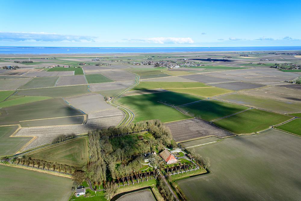Nederland, Friesland, Gemeente Ferweradeel, 28-02-2016; Hegebeintum (Hogebeintum), Harsta State met naastgelegen boerderij. De State is een stins, historisch landhuis. In de achtergrond de Waddenzee.<br /> Harsta mansion with adjacent farm, northern Friesland.<br />  <br /> luchtfoto (toeslag op standard tarieven);<br /> aerial photo (additional fee required);<br /> copyright foto/photo Siebe Swart