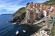 "One of the five villages that are a part of the ""Cinque Terre"", a rugged portion of coast on the Italian Riviera. Riomaggiore is caught between two steep terraced hills descending in steep cliffs to the sea with its delightfully colored houses built vertically."