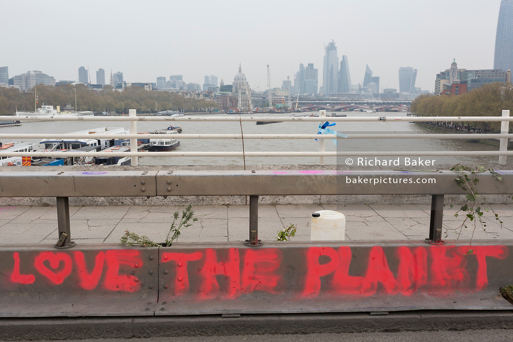 Graffiti written by Climate Change activists with Extinction Rebellion as they campaign for a better future for planet Earth after blocking Waterloo Bridge and as part of a multi-location 5-day Easter protest around the capital, on 16th April 2019, in London, England.
