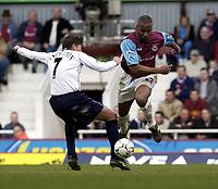 Picture: Henry Browne<br />Date: 01/03/2003<br />West Ham United v Tottenham Hotspur FA Barclaycard Premiership<br />Les Ferdinand of West Ham skips over a challenge from Darren Anderton of Spurs