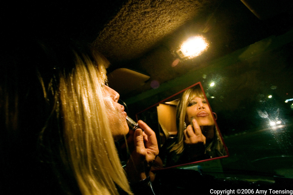 PARIS, FRANCE - APRIL 18: A prostitute in Bois de Boulogne lets potential clients know she is available by illuminating herself in the front seat of her camper van April 18, 2006 in Paris France. She performs her work in the back. Half the world's population now lives in cities, and this proportion is expected to grow by sixty percent in the next twenty-five years. Urban parks are valued as public spaces that enhance almost everything about the cities they serve, from job opportunities, youth development, public health, community building and an appreciation for nature and conservation. Since most urban dwellers experience nature through city park systems, these slices of green take on more and more value. The city of Paris has over four hundred parks, ranging from the 2,000 acre Bois de Boulogne, to the Jardin d'Acclimatation for children, to the Promenade Plantee, the only elevated park in the world. (Photo by Amy Toensing) _________________________________<br />