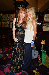 Left to right, CHARLOTTE TILBURY and LAURA BAILEY at a dinner to celebrate the launch of Genetic - Liberty Ross hosted by Liberty Ross and Ali Fatourechi at Annabel's, 44 Berkeley Square, London on 3rd September 2014.