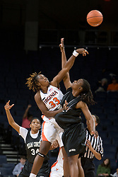 Virginia Cavaliers C Aisha Mohammed (33) goes up for the opening tip.  The Virginia Cavaliers women's basketball team faced Team Concept in an exhibition basketball game at the John Paul Jones Arena in Charlottesville, VA on November 5, 2007.