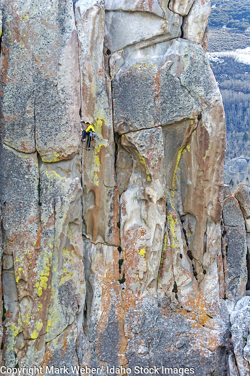 Elijah Weber rock climbing a route called Thin Slice which is rated 5,10 and located on Parkinglot Rock at the City Of Rocks National Reserve near the town of Almo in southern Idaho
