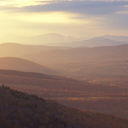 Twin Mountain, NH. The view west at sunset from Middle Sugarloaf in the White Mountain National Forest.  Fall.