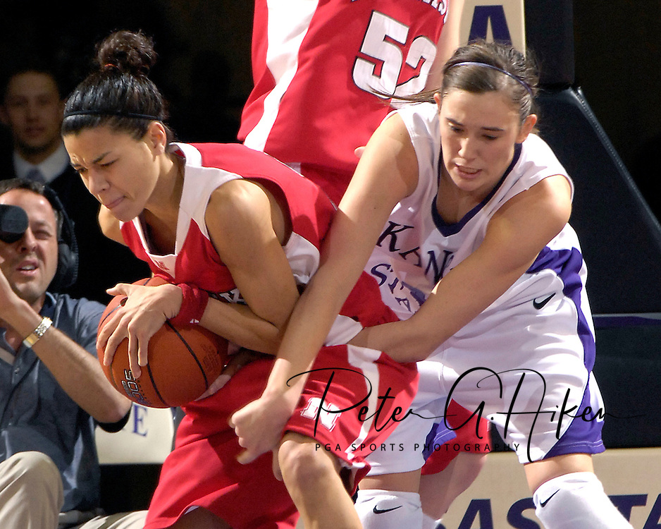 Nebraska guard Ashley Ford (L) pulls the ball away for Kansas State forward Ashley Sweat (R), during first half play at Bramlage Coliseum in Manhattan, Kansas, February 7, 2007.  The  Huskers lead the Wildcats at halftime 32-25.