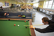 An employee of Sainsbury's plays pool during his lunch break in the canteen of the company's Waltham Point logistics depot