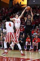 17 February 2018:  Matt Hein attempts to block a shot by Wyatt Lohaus during a College mens basketball game between the University of Northern Iowa Panthers and Illinois State Redbirds in Redbird Arena, Normal IL