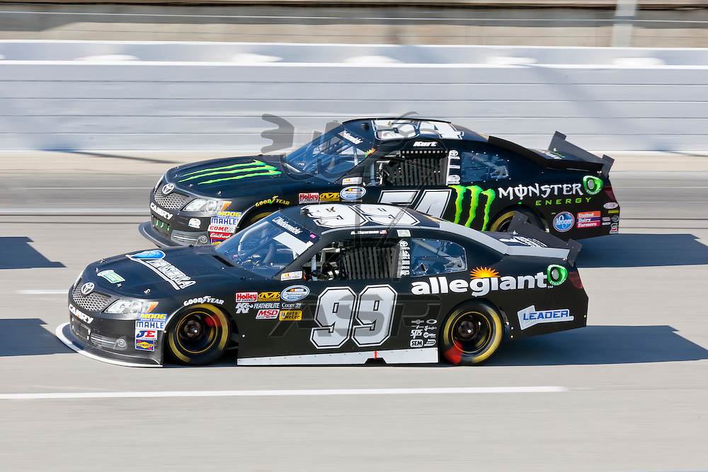 SPARTA, KY - SEP 22, 2012:  Kurt Busch (54) and Alex Bowman (99) race during the Kentucky 300 at the Kentucky Speedway in Sparta, KY.