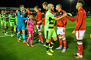 The respect handshake during the EFL Sky Bet League 2 match between Forest Green Rovers and Swindon Town at the New Lawn, Forest Green, United Kingdom on 22 September 2017. Photo by Shane Healey.