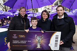 CARDIFF, ENGLAND - Tuesday, February 21, 2017: Stefan Roberts, the first person to buy a ticket poses with Jayne Ludlow, 2017 Women's Champions Legue Final Ambassador and Capitol FM Radio Presenters in the Hayes, Cardiff to promote the UEFA Champions League Finals being staged in Cardiff this June. (Pic by Paul Greenwood/Propaganda)