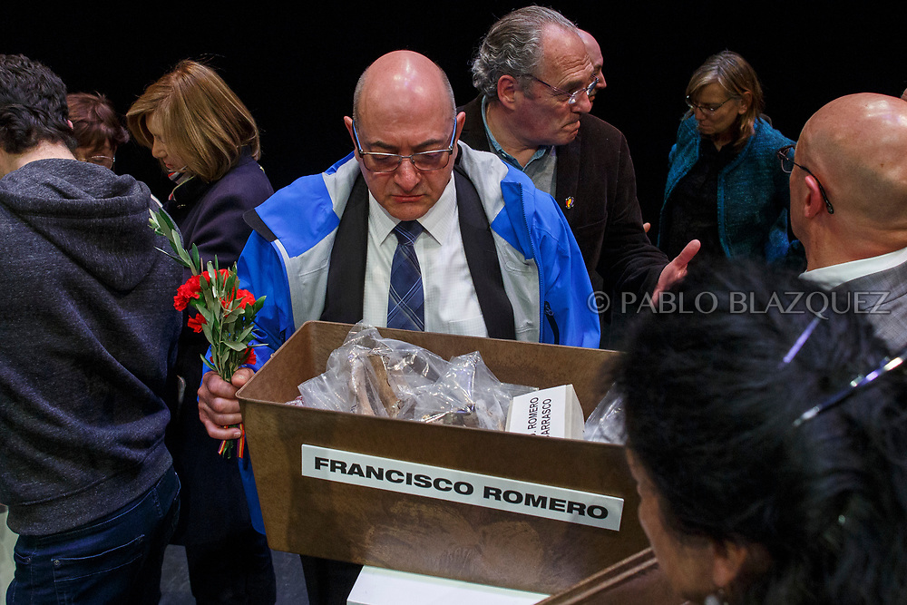 14/04/2018. Relatives check the items of a coffin containing the remains of victim of Spain Civil War Francisco Romero during a homage to hand the remains of victims of Spain's Civil War exhumed in Cobertelada and Calata&ntilde;azor to their relatives at the Centro Cultural Palacio de la Audiencia on April 14, 2018 in Soria, Spain. La Asociacion Soriana Recuerdo y Dignidad (ASRD) 'The Soria Association for Memory and Dignity' celebrated a tribute to hand over the remains of civil war victims to their families. The Society of Sciences of ARANZADI helped with the research, exhumation and identification of the bodies, after villagers passed the information about the mass grave, 81 years after the assassination took place, to the ASRD. Seven people were assassinated around August 25, 1936 by Falangists, as part of General Francisco Franco armed forces, and buried in the 'Fosa de los Maestros' (Teachers Mass Grave) near Cobertelada, Soria, after being taken from prison of Almazan during the Spanish Civil War. Five of them were teachers in the region, and also friends of Spanish writer Antonio Machado. The other two still remain unidentified. Another body was assassinated by Falangists accompanied by a priest in 1936, and was exhumed on 23 September of 2017 near Calata&ntilde;azor, Soria. It belonged to Abundio Andaluz, a politician, lawyer and musician in Soria.<br /> Spain's Civil War took the lives of thousands of people on both sides, and civilians. But Franco continued his executions after the war has finished. Teachers, as part of the education sector, were often a target of Franco's forces. Spanish governments has never done anything to help the victims of the Civil War and Franco's dictatorship while there are still thousands of people missing in mass graves around the country. (&copy; Pablo Blazquez)