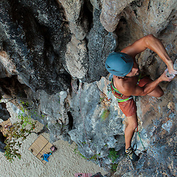 Eric Wickenheiser climbing beside the beautiful Andaman Sea on the secluded island of Lao Liang, Trang Province, Thailand