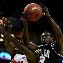 Mar 26, 2011; New Orleans, LA; Butler Bulldogs forward Khyle Marshall (23) grabs a rebound over Florida Gators forward/center Patric Young (4) during the first half of the semifinals of the southeast regional of the 2011 NCAA men's basketball tournament at New Orleans Arena.   Mandatory Credit: Derick E. Hingle
