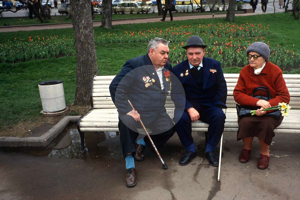 Russian World War II veterans trade stories sitting on a bench as they celebrate Victory Day in the Bolshoi Gardens in Moscow, Russia.
