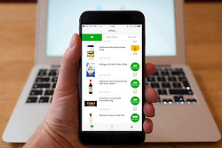Using iPhone smartphone to display products for sale in Morrisons More online mobile shop